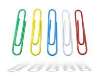 les clips bleus verdissent le jaune de papier multicolore Photos stock