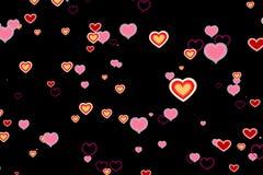 Les coeurs colorés d'aspiration de Saint Valentin forment sur le fond noir, amour de fête de Saint Valentin de vacances Photos stock