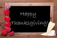 Les coeurs de Chalkbord, rouges et jaunes, textotent le thanksgiving heureux Images libres de droits