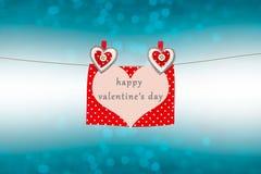 Les coeurs et la carte de valentines avec le jour heureux du ` s de valentine textotent Photographie stock