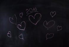Les coeurs et la nouvelle année 2016, dentellent peint Photos libres de droits