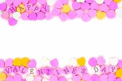 Les coeurs heureux de sucrerie de jour de valentines doublent la frontière au-dessus du blanc Photos libres de droits
