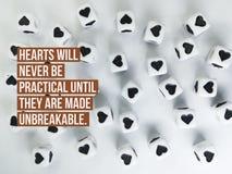 Les coeurs ne seront jamais pratiques jusqu'à ce qu'ils soient faits à citation incassable photos stock