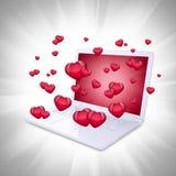 Les coeurs rouges volent hors de l'ordinateur portable Images stock