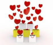 Les coeurs tombant dans le cadeau met en sac Photos libres de droits
