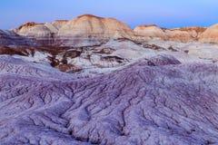 Les collines et les bad-lands brillamment colorés dans le désert peint par s de ` de l'Arizona semblent presque être d'un autre m Images libres de droits