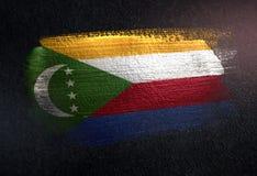 Les Comores diminuent fait de la peinture métallique de brosse sur le mur foncé grunge illustration libre de droits