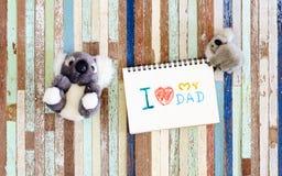 Les concepts de carte de voeux de jour de pères avec I aiment mon texte de papa et c Photo stock