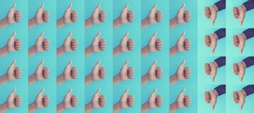 Les concepts de résultat de différenciation ou d'effet avec le pouce d'apparence de main présente comme et déteste, positif ou le photos stock