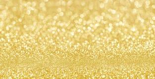 Les confettis d'or de texture de scintillement de miroitement ont con?u le fond images libres de droits