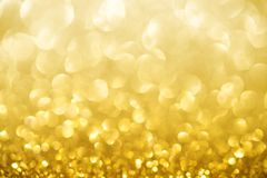 Les confettis d'or de texture de scintillement de miroitement ont con?u le fond photos libres de droits