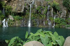 Les Cormorans waterfall at Saint Gilles on Reunion. Island, France Stock Photography