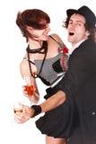 Les couples équipent et fille avec la danse de vin. Photo stock