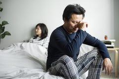 Les couples asiatiques ont un argument image stock