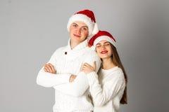Les couples célèbrent Noël dans le studio Photographie stock