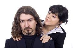 les couples d'affaires équipent la femme Images libres de droits