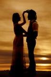 Les couples de cowboy silhouettent sa main son chapeau Photographie stock
