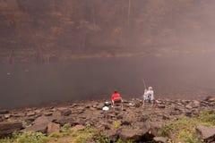 Les couples pilotent la pêche Image libre de droits
