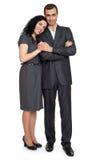 Les couples romantiques dans l'amour, habillé dans le costume noir, ont isolé le blanc Photos libres de droits