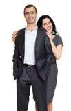 Les couples romantiques dans l'amour, habillé dans le costume noir, ont isolé le blanc Image stock