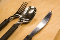 Les couverts ont placé avec la fourchette, le couteau et la cuillère photographie stock