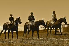 Les cowboys heded à un rassemblement et à une sépia de marquage à chaud Images libres de droits