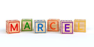 Les cubes en bois d'isolement en jouet avec des lettres avec le nom marcel Photos libres de droits