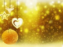 Les décorations d'étoiles de neige de boule de cerfs communs de coeur de jaune d'or de Noël de fond brouillent la nouvelle année  Photographie stock libre de droits