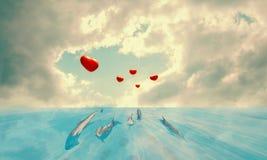 Les dauphins avec les ballons rouges avec le coeur forment sur leurs queues dans un paysage étonnant illustration libre de droits