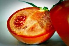 Les deux moitiés de la tomate Photographie stock libre de droits