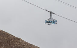 LES DIABLERETS, SWIZTERLAND - JULY 22: Ski lift to area Glacier Royalty Free Stock Image