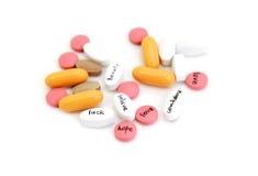 Les différentes pilules avec se connecte le blanc Image libre de droits