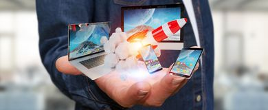 Les dispositifs se reliants et la fusée de démarrage 3D de technologie d'homme d'affaires rendent Images stock