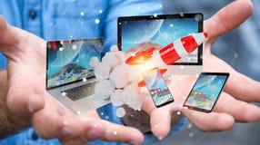 Les dispositifs se reliants et la fusée de démarrage 3D de technologie d'homme d'affaires rendent Photographie stock libre de droits