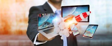 Les dispositifs se reliants et la fusée de démarrage 3D de technologie d'homme d'affaires rendent Images libres de droits