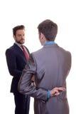 Les doigts d'hommes d'affaires ont croisé en raison de l'espoir ou du mensonge Photos libres de droits