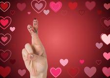 Les doigts du ` s de Valentine aiment le fond de couples et de coeurs Photo libre de droits