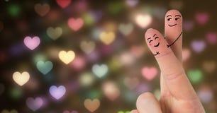 Les doigts du ` s de Valentine aiment rougeoyer de scintillement de lumières de couples et de bokeh Photo stock