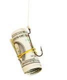 Les dollars comme amorce s'arrêtent sur un crochet Photo libre de droits