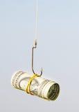 Les dollars comme amorce s'arrêtent sur un crochet Images stock