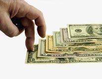 Les dollars de 1 à 100, les doigts intensifient. Images stock