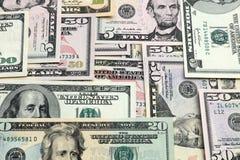 les dollars de fond nous ont isolés blancs Image stock