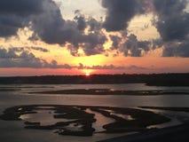 Les eaux de coucher du soleil Photo libre de droits