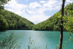 Les eaux toujours des lacs Plitvice Image libre de droits