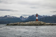 Les Eclaireurs Red and white lighthouse - Beagle Channel, Ushuaia, Argentina Stock Photo
