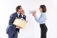 Les employés fâchés contestent l'avance photo stock