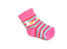 les enfants de fond ont isolé des chaussettes de s blanches Image stock