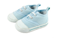 les enfants de fond ont isolé des chaussures de s blanches Images libres de droits