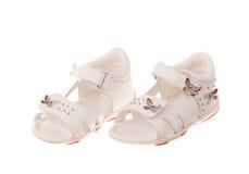 les enfants de fond ont isolé des chaussures de s blanches Image stock