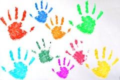 Les enfants ont coloré la copie de main sur le fond blanc photos stock